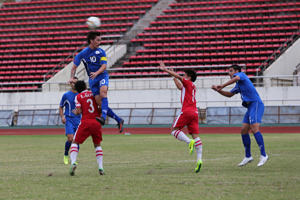 The Matao's Jason Cunliffe attempts to flick the ball back toward the goal with a header during a FIFA international friendly match against Laos. Guam drew 1-1 with Laos.