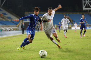 Guam's Travis Nicklaw battles for possession of the ball with Chinese Taipei's Chen Ting Yang during an opening day match of the EAFF East Asian Cup semifinal round at the Taipei Municipal Stadium in Taipei City. Guam defeated Chinese Taipei 2-1.