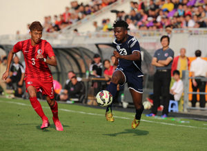 Guam's Shane Malcolm begins his run to the goal from the left side ahead of Hong Kong's Cheng King Ho in a FIFA international friendly match at Mong Kok Stadium in Hong Kong Saturday. Hong Kong escaped with a 1-0 win.