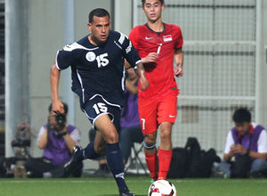 Guam's Shawn Nicklaw begins his run up the left flank ahead of Singapore's Gabriel Quak during a FIFA international friendly at the Jalan Besar Stadium in Singapore Tuesday. Both teams battled to a 2-2 draw.