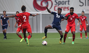 Guam's Shane Malcolm controls the ball facing defensive pressure from Singapore's Shakir Hamzah (2) and Hariss Harun (14) during a FIFA international friendly at the Jalan Besar Stadium in Singapore Tuesday. Both teams battled to a 2-2 draw.