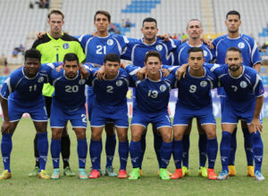 Guam's starting eleven players pose for a group photo before the team's match against Chinese Taipei on Day 2 of the EAFF East Asian Cup Semifinal Round tournament at the Taipei Municipal Stadium in Taipei City. Front row from left to right are Shane Malcolm, A.J. DeLaGarza, Dylan Naputi, Ryan Guy, Marcus Lopez, and John Matkin. Back row from left to right are Doug Herrick, Mason Grimes, Shawn Nicklaw, Jason Cunliffe, and Travis Nicklaw.