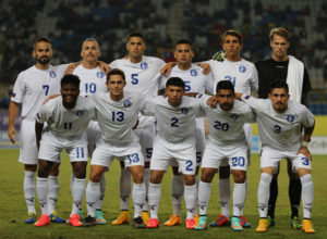 Guam's starting eleven players pose for a group photo before the team's match against Chinese Taipei on opening day of the EAFF East Asian Cup Semifinal Round tournament at the Taipei Municipal Stadium in Taipei City. Front row from left to right are Shane Malcolm, Ryan Guy, Dylan Naputi, A.J. DeLaGarza, and Jonahan Romero. Back row from left to right are John Matkin, Jason Cunliffe, Travis Nicklaw, Shawn Nicklaw, Mason Grimes, and Douglas Herrick.