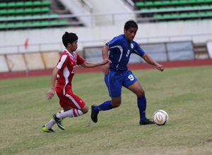 The Matao's Ian Mariano controls the ball facing defensive pressure from Laos' Manolom Phomsouvanh during a FIFA international friendly match against Laos. Guam drew 1-1 with Laos.