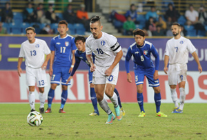 Guam captain Jason Cunliffe prepares to take a penalty kick against Chinese Taipei during an opening day match of the EAFF East Asian Cup semifinal round at the Taipei Municipal Stadium in Taipei City. Guam defeated Chinese Taipei 2-1.