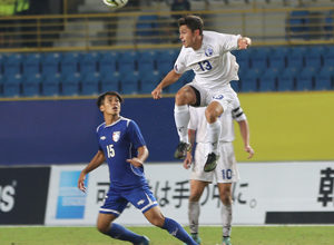 Guam's Ryan Guy leaps to head the ball over Chinese Taipei's Chen Yi Wei during an opening day match of the EAFF East Asian Cup semifinal round at the Taipei Municipal Stadium in Taipei City. Guam defeated Chinese Taipei 2-1.
