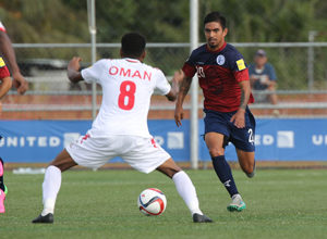 Guam's A.J. DeLaGarza moves to advance the ball past Oman's Eid Al-Farsi during a match of the 2018 FIFA World Cup Russia and AFC Asian Cup UAE 2019 Preliminary Joint Qualification Round 2 at the Guam Football Association National Training Center Sept. 8. The teams battled to a 0-0 draw.