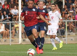 Guam's Alexander Lee runts toward the goal to attempt a shot against Oman during a match of the 2018 FIFA World Cup Russia and AFC Asian Cup UAE 2019 Preliminary Joint Qualification Round 2 at the Guam Football Association National Training Center Sept. 8. The teams battled to a 0-0 draw.