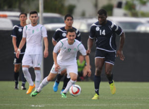 Guam's Brandon McDonald gets ahead of Turkmenistan's Astanov Umidjan to take the ball through the midfield during Guam's first-ever FIFA World Cup Qualifier match held in Guam Thursday afternoon at the Guam Football Association National Training Center. Guam defeated Turkmenistan 1-0.