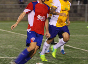 Quality Distributors FC's Jan-Willem Staman controls the ball in the midfield in a 2014-2015 Budweiser Soccer League Division I match against the Rovers FC.