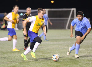 The Rovers FC's Jason Cunliffe prepares to sprint past the Paradise Fitness Sidekicks' last line of defense to the goal in a 2014-2015 Budweiser Soccer League Division I match.