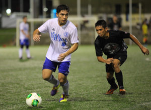 Guam Shipyard's Mark Chargualaf looks to pass the ball in a 2014-2015 Budweiser Soccer League Division I match against Doosan FC.