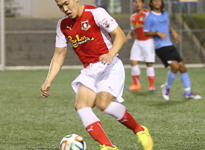 The Payless Supermarkets Strykers FC's Min Sung Choi controls the ball in the midfield in a 2014-2015 Budweiser Soccer League Division I match against the Paradise Fitness Sidekicks.