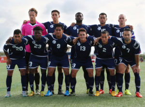 Guam's starting eleven players pose for a photo before the team's opening match of its 2018 FIFA World Cup Qualifier bid at the Guam Football Association National Training Center. First row from left to right are A.J. DeLaGarza, Shane Malcolm, Ian Mariano, Ryan Guy, Alexander Lee, and John Matkin. Back row from left to right are Doug Herrick, Mason Grimes, Brandon McDonald, Shawn Nicklaw, and captain Jason Cunliffe. Guam defeated Turkmenistan 1-0.