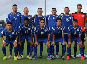 The starting eleven players from Guam pose for a group photo before the team's match against Mongolia on Day 2 of the EAFF East Asian Cup Round 1 tournament at the Guam Football Association National Training Center.