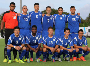 The starting eleven players from Guam pose for a group photo before the team's match against Macau on opening day of the EAFF East Asian Cup Round 1 tournament at the Guam Football Association National Training Center. Front row from left to right are Jonahan Romero, Shane Malcolm, Ryan Guy, Christian Schweizer, and Dylan Naputi. Standing from left to right are Bijan Gloston, Jason Cunliffe, Travis Nicklaw, John Matkin, Micah Paulino, and Shawn Nicklaw.