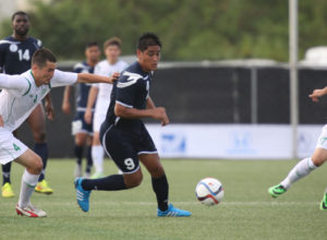 Guam's Ian Mariano finds space to get past Turkmenistan's Rahim Baltayev during Guam's first-ever FIFA World Cup Qualifier match held in Guam Thursday afternoon at the Guam Football Association National Training Center. Guam defeated Turkmenistan 1-0.