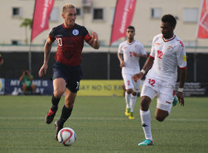 Guam captain Jason Cunliffe leads a run down the right side ahead of Oman's Ahmed Mubarak during a match of the 2018 FIFA World Cup Russia and AFC Asian Cup UAE 2019 Preliminary Joint Qualification Round 2 at the Guam Football Association National Training Center Sept. 8. The teams battled to a 0-0 draw.