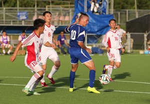 Guam's Jason Cunliffe looks to pass the ball after being swarmed by Mongolia defenders in the box during a Day 2 match of the EAFF East Asian Cup Round 1 tournament Wednesday at the Guam Football Association National Training Center. Guam blanked Mongolia 2-0.