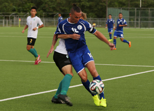 Guam Matao captain Jason Cunliffe gets held back by Macau's Ho Chi Fong as he tries to make his way to the goal in an opening day match of the EAFF East Asian Cup Round 1 at the Guam Football Association National Training Center. Guam and Macau battled to a scoreless draw.