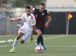 Guam's John Matkin and Oman's Ali Sulaiman Al Busaidi get into a foot race to the ball during a match of the 2018 FIFA World Cup Russia and AFC Asian Cup UAE 2019 Preliminary Joint Qualification Round 2 at the Guam Football Association National Training Center Sept. 8. The teams battled to a 0-0 draw.