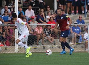 Guam's John Matkin looks ahead for a teammate as Oman's Ali Sulaiman Al Busaidi anticipates a pass into the box during a match of the 2018 FIFA World Cup Russia and AFC Asian Cup UAE 2019 Preliminary Joint Qualification Round 2 at the Guam Football Association National Training Center Sept. 8. The teams battled to a 0-0 draw.