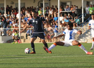 Guam's John Matkin gets around the defense of India's Dhanapal Ganesh during a 2018 FIFA World Cup Russia and AFC Asian Cup UAE 2019 Joint Qualification Round 2 match at the Guam Football Association National Training Center Tuesday. Guam defeated India 2-1.