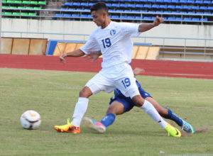 Guam's Kyle Perez beats a slide tackle to stay in control of the ball in an opening match of the AFC U16 Championship Group H Qualifier against Brunei-Darussalam in Vientiane, Laos. Brunei-Darussalam defeated Guam 4-1.