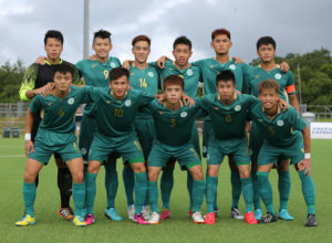 The starting eleven players from Macau pose for a group photo before the team's match against the Northern Mariana Islands on Day 2 of the EAFF East Asian Cup Round 1 tournament at the Guam Football Association National Training Center.