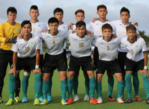 The starting eleven players from Macau pose for a group photo before the team's match against Guam on opening day of the EAFF East Asian Cup Round 1 tournament at the Guam Football Association National Training Center. Front row from left to right are Choi Weng Hou, Chan Man, Pang Chi Hang, Kou Ut Cheong, and Ho Chi Fong. Standing from left to right are Ho Man Fai, Leong Ka Hang, Cheang Cheng Leong, Vernon Wong, Kong Cheng Hou, and Lei Ka Him.