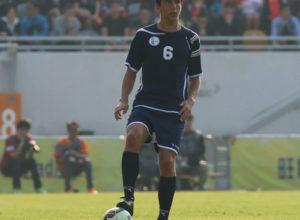Guam's Mason Grimes looks to pass the ball during the Matao's FIFA international friendly match against Hong Kong at Mong Kok Stadium March 28.