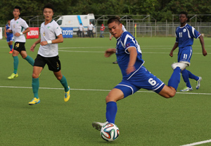 Guam Matao's Micah Paulino attempts a shot against Macau from the left side in an opening day match of the EAFF East Asian Cup Round 1 at the Guam Football Association National Training Center. Guam and Macau battled to a scoreless draw.