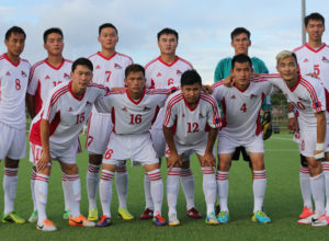 The starting eleven players from Mongolia pose for a group photo before the team's match against Guam on Day 2 of the EAFF East Asian Cup Round 1 tournament at the Guam Football Association National Training Center.