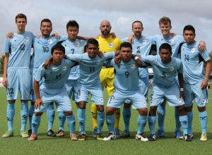 The starting eleven players from the Northern Mariana Islands pose for a group photo before the team's match against the Mongolia on opening day of the EAFF East Asian Cup Round 1 tournament at the Guam Football Association National Training Center. Front row from left to right are Kennedy Izuka, Jireh Yobech, John Raymond Taisacan, and Michael Barry. Standing from left to right are Joel Fruit, Jonathan Takano, Joe Miller, Johann Noetzel, Nicolas Swaim, Kirk Schuler, and Daniel Agulto.