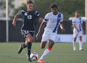 Guam's Ryan Guy pulls ahead of India's Dhanapal Ganesh during a 2018 FIFA World Cup Russia and AFC Asian Cup UAE 2019 Joint Qualification Round 2 match at the Guam Football Association National Training Center Tuesday. Guam defeated India 2-1.