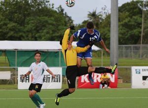 Macau goalkeeper Ho Man Fai manages to punch out a header by Guam's Ryan Guy in an opening day match of the EAFF East Asian Cup Round 1 at the Guam Football Association National Training Center. Guam and Macau battled to a scoreless draw.