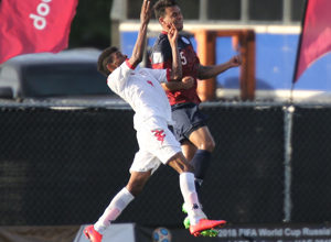 Guam's Shawn Nicklaw rises high to win a header against Oman's Raed Saleh during a match of the 2018 FIFA World Cup Russia and AFC Asian Cup UAE 2019 Preliminary Joint Qualification Round 2 at the Guam Football Association National Training Center Sept. 8. The teams battled to a 0-0 draw.