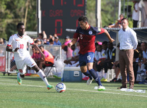 Guam's Shawn Nicklaw controls the ball ahead of Oman's Qasim Said during a match of the 2018 FIFA World Cup Russia and AFC Asian Cup UAE 2019 Preliminary Joint Qualification Round 2 at the Guam Football Association National Training Center Sept. 8. The teams battled to a 0-0 draw.