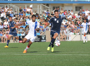 Guam's Travis Nicklaw receives a pass ahead of India's Arnab Kumar Mondal during a 2018 FIFA World Cup Russia and AFC Asian Cup UAE 2019 Joint Qualification Round 2 match at the Guam Football Association National Training Center Tuesday. Guam defeated India 2-1.